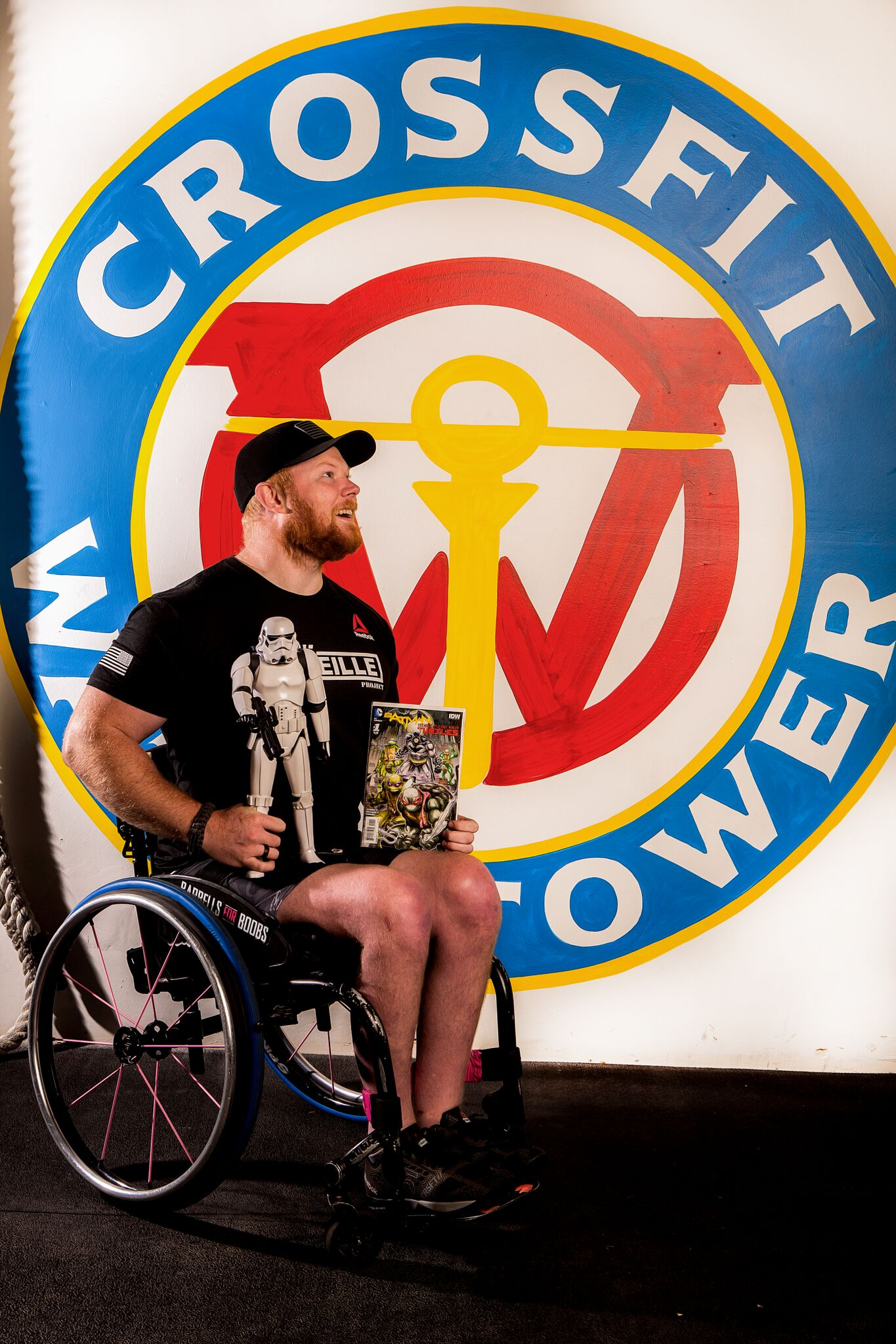 Kevin Ogar, Owner of CrossFit Watchtower, coaches CrossFit in Denver